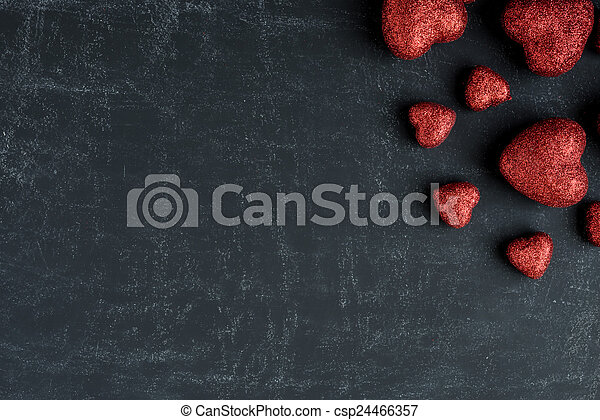 Red Hearts on a Chalkboard for Valentines Day - csp24466357