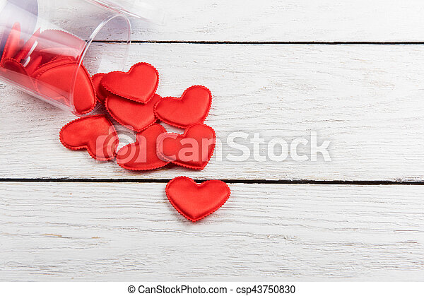 Red hearts on a white wood background - csp43750830