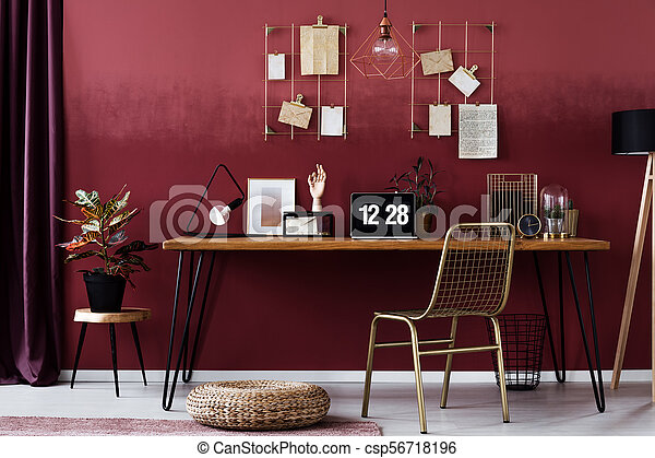 Red Home Office Interior A Wooden Desk And Chair In A Dark Red Home Office Interior