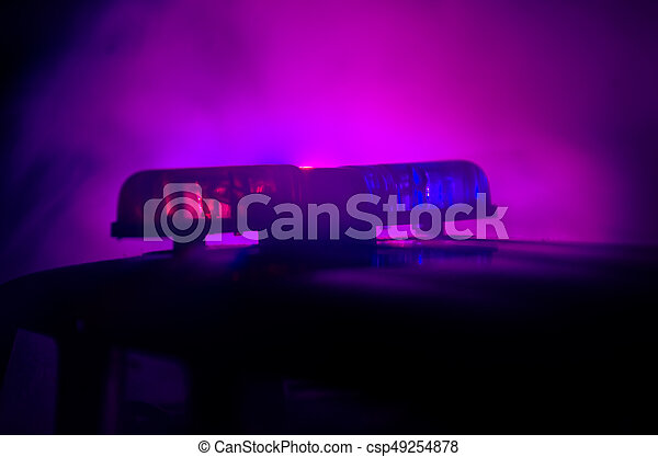 Red light flasher atop of a police car. City lights on the background. Police government concept - csp49254878