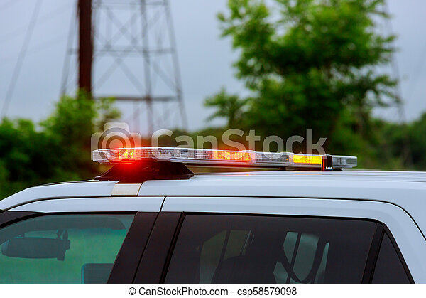 Red light flasher of a Siren on police car flashing - csp58579098