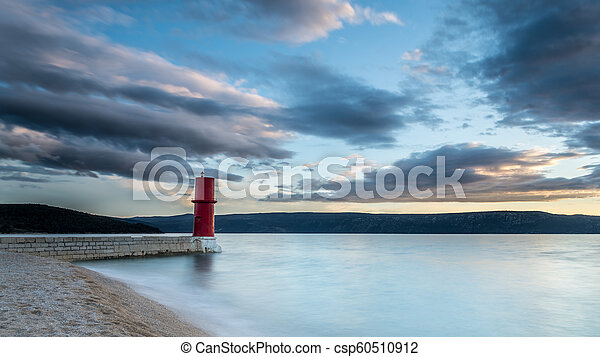 Red lighthouse of Cres on a cloudy day in spring - csp60510912