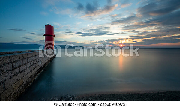 Red lighthouse of Cres on a sunny evening in spring - csp68946973