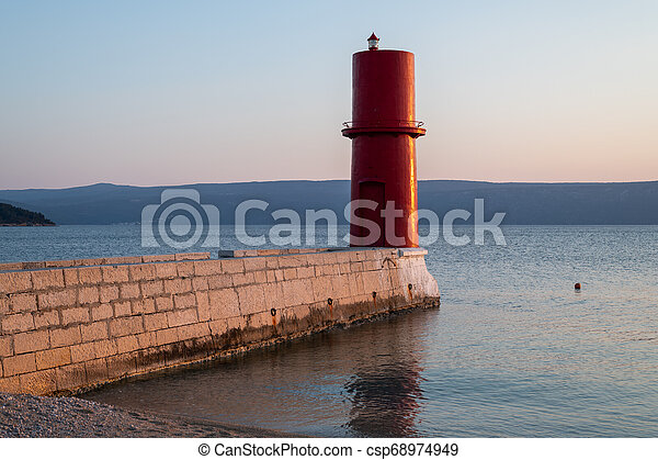 Red lighthouse of Cres on a sunny evening in spring - csp68974949