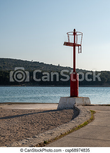 Red lighthouse of Cres on a sunny evening in spring - csp68974835