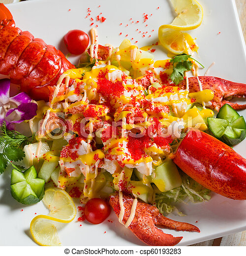 Red lobster meal on a white plate - csp60193283