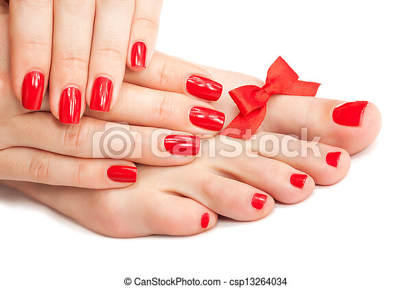 Red manicure and pedicure with a bow - csp13264034
