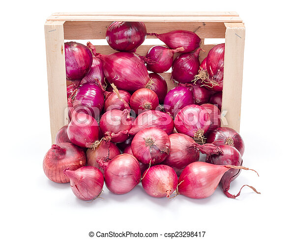Red onion bulbs in wooden crate - csp23298417