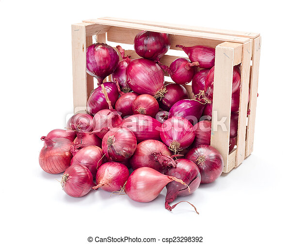 Red onion bulbs in wooden crate - csp23298392