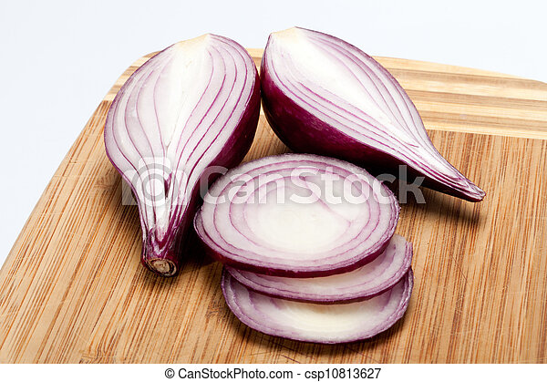 Red onions on a wooden board - csp10813627