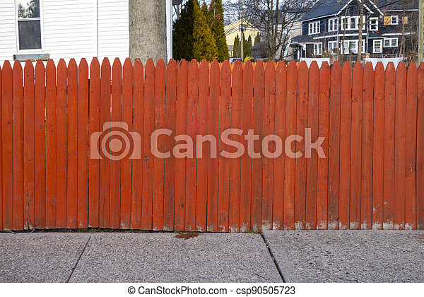 Red orange picket fence of a suburban naberhood in the united states - csp90505723