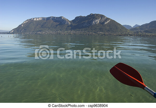 Red paddle of canoe and Annecy lake - csp9638904