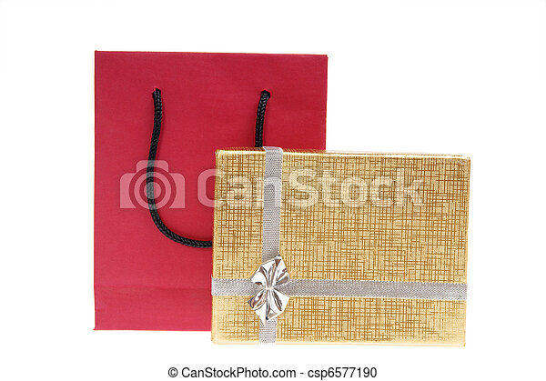 red paper bag and gold gift box with bow - csp6577190