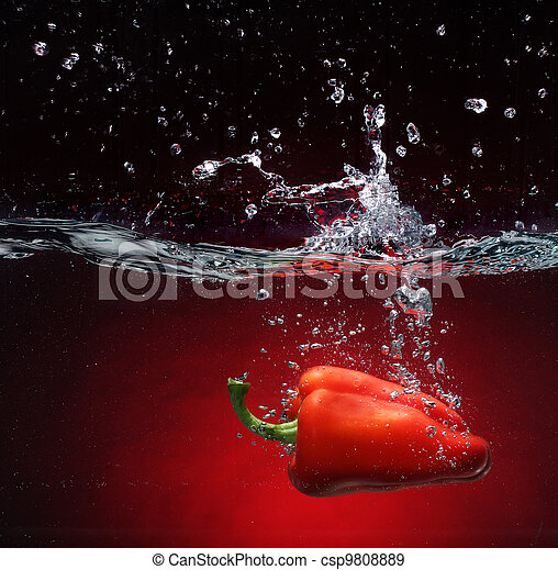 Red pepper falling into water - csp9808889