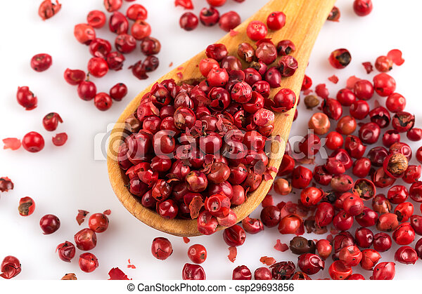 red peppercorns in wooden spoon isolated - csp29693856