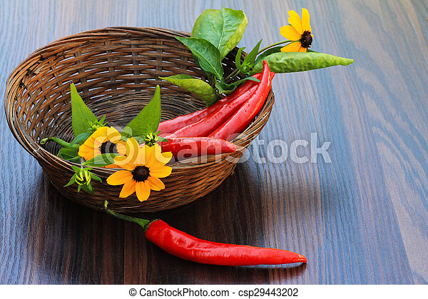 red peppers with leaves and yellow daisies - csp29443202