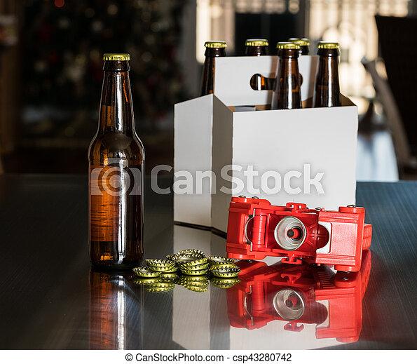 Red plastic capper to put metal caps on beer bottle