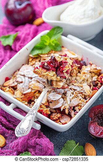 Red plum crumble. Healthy breakfast. - csp72851335