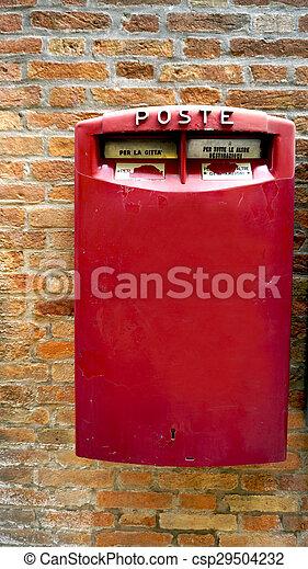 red postal box public on brick wall - csp29504232