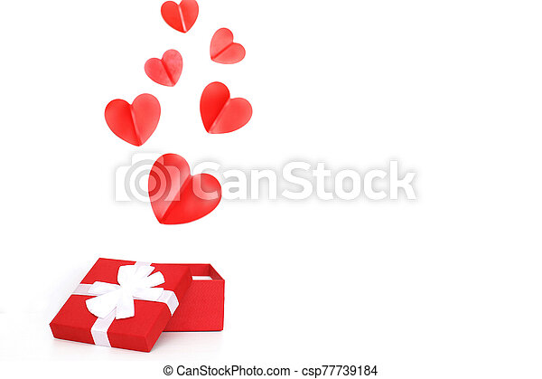 red present box with red hearts on a white background - csp77739184