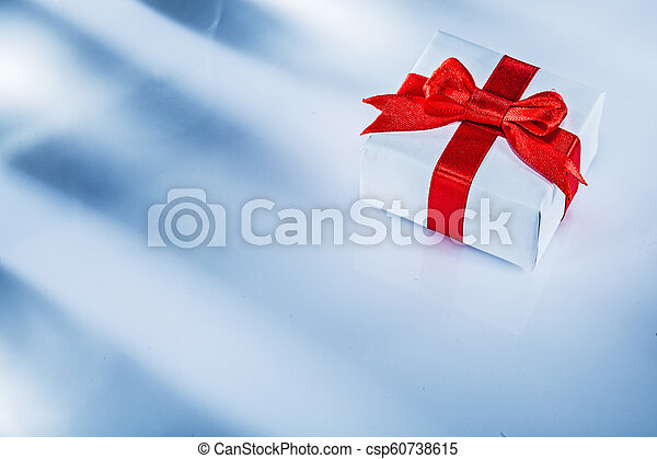 Red present box with tied bow on white background - csp60738615