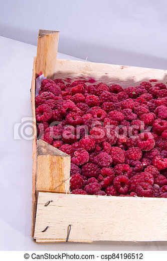 Red raspberries in the box - csp84196512
