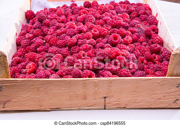 Red raspberries in the box - csp84196555