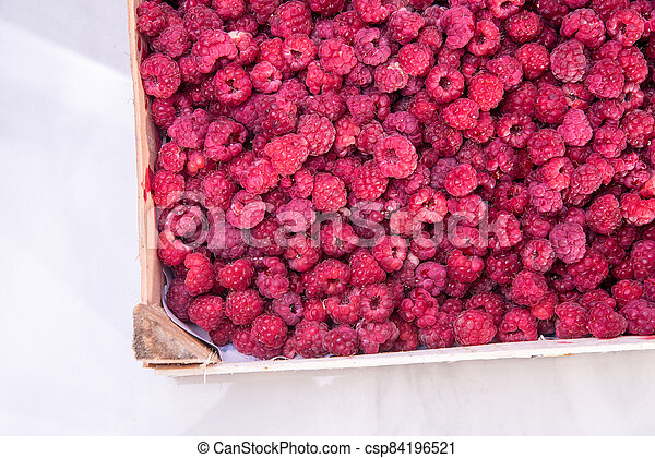 Red raspberries in the box - csp84196521