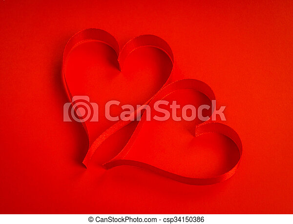 Red ribbon hearts on red background For Valentines day - csp34150386