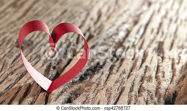 Red ribbon hearts on wooden background, Valentines day concept - csp42768727