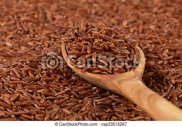 Red rice in a wooden spoon - csp33515267