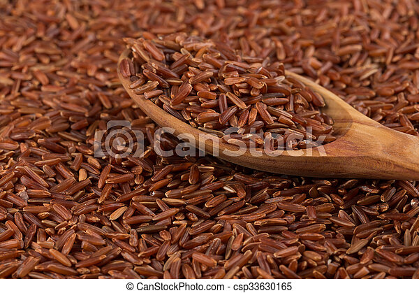 Red rice in a wooden spoon - csp33630165