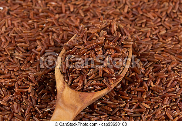 Red rice in a wooden spoon - csp33630168