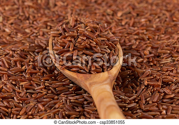 Red rice in a wooden spoon - csp33851055