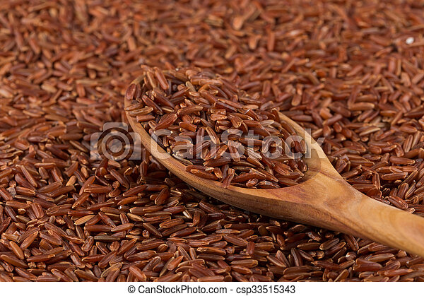 Red rice in a wooden spoon - csp33515343