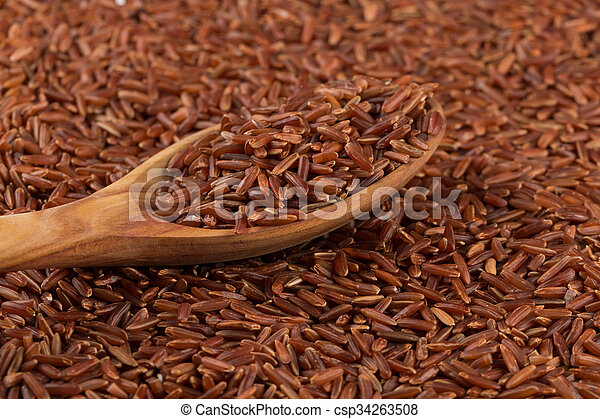 Red rice in a wooden spoon - csp34263508