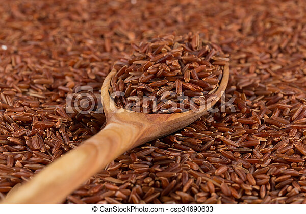 Red rice in a wooden spoon - csp34690633