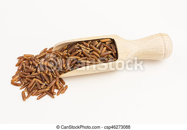 red rice on wooden shovel - csp46273088