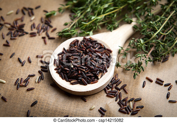 Red rice on wooden spoon - csp14215082