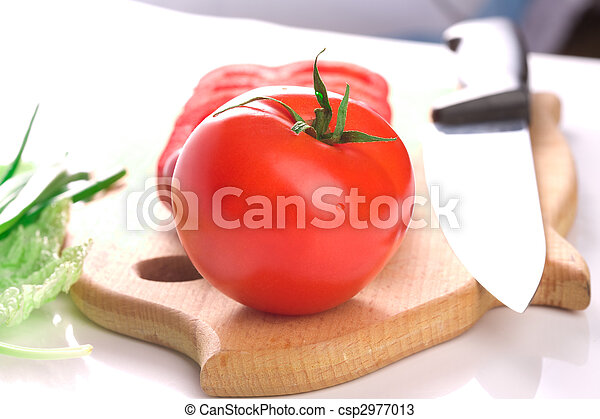 Red ripe fresh tomato on cutting board with knife - csp2977013