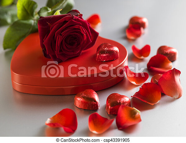 Red rose and box with red hearts on a white background - csp43391905