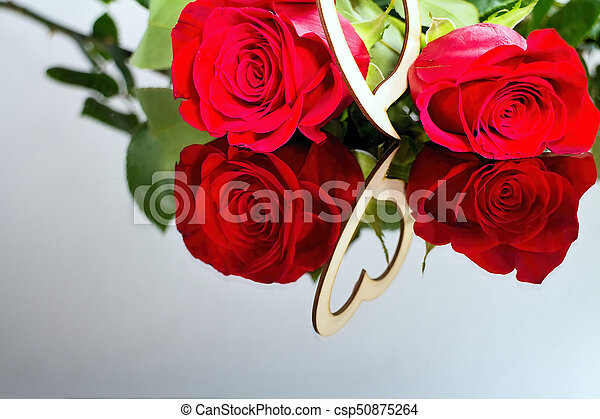 red roses with heart with reflection in mirror valentine s day