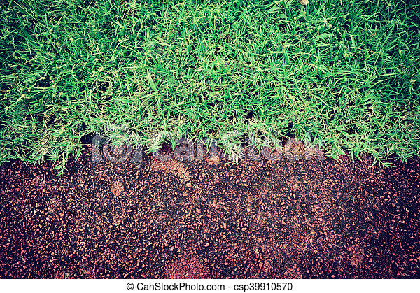 red running track and green grass in stadium - csp39910570
