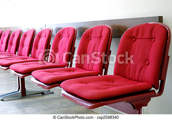 red seats in a row in a waiting room - csp2598340