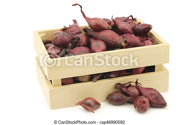 red seed onions in a wooden box - csp46990592