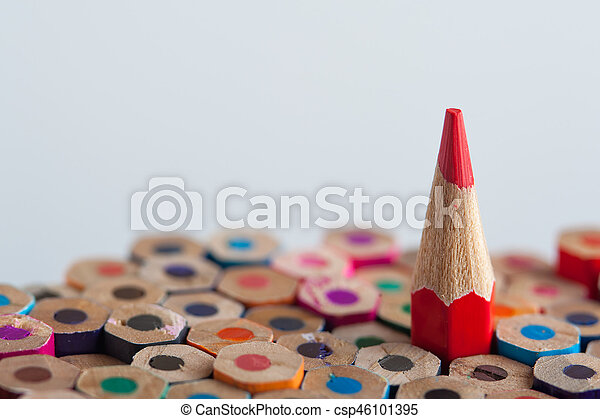 red sharpened pencil among colorful crayons pencils background with