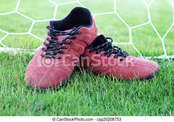 Red shoes green grass in a stadium. - csp20208753
