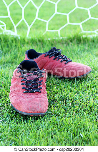 Red shoes green grass in a stadium. - csp20208304