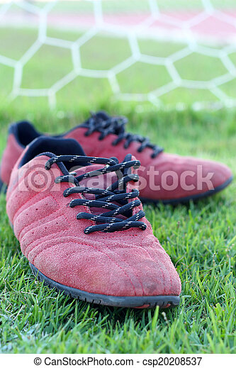 Red shoes green grass in a stadium. - csp20208537