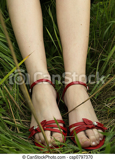 Red shoes in grass - csp0797370